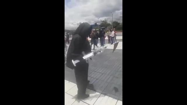 Bogota, Colombia: Grim Reaper outside vaccination center